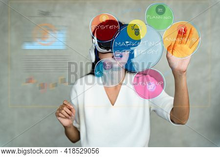 Medium Shot Of Asian Woman Wearing Virtual Reality Headset While Working With Business Strategy Popu