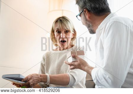 Elderly Woman Surprisingly Face While Looking At The Present That Her Husband Give To Her, Romantic