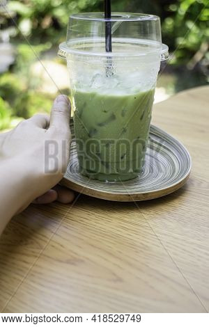 Female Hand Holding Iced Green Tea Drink In Disposable Take Away Cup, Stock Photo