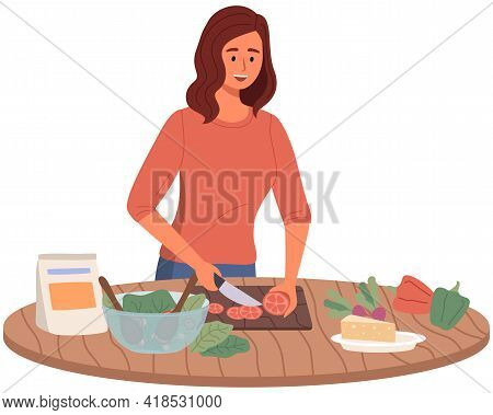 Woman Preparing Salad Using Vegetarian Ingredients In Kitchen. Proper Nutrition, Healthy Lifestyle A