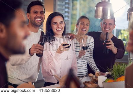 Group Of Multi Cultural Friends Drinks Party Making A Toast At Home Together
