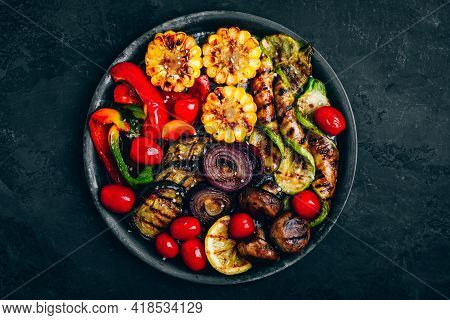 Grilled Vegetables In Bowl On Dark Stone Background, Top View. Zucchini, Bell Peppers, Sweet Corn, T