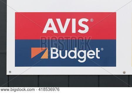 Billund, Denmark - February 20, 2019: Avis Budget Logo On A Wall. Avis Budget Group Is The American