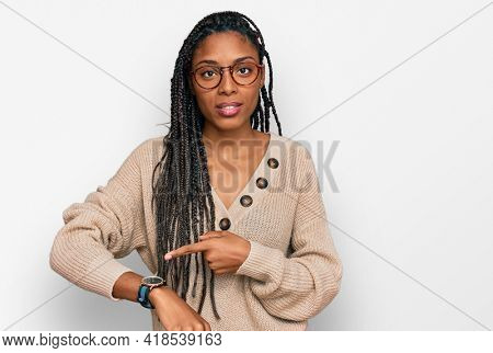 African american woman wearing casual clothes in hurry pointing to watch time, impatience, upset and angry for deadline delay