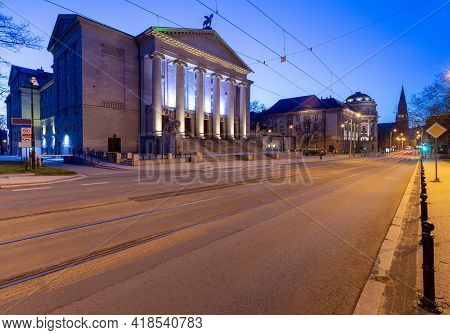 Poznan. Facade Of The Building Of The Opera House At Sunrise.