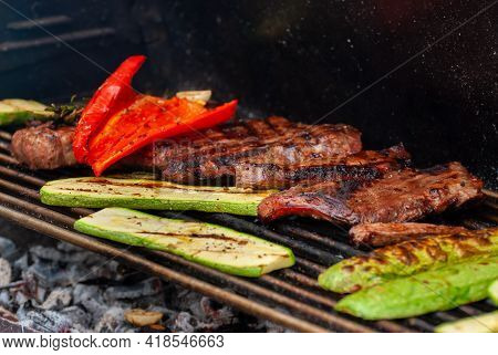 Delicious Grilled Meat With Vegetables. Grilling Steaks.