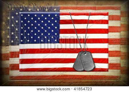 Military dog tags on American flags