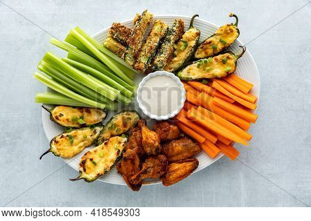 Top Down View Of An Appetizer Platter Filled With Homemade Baked Appetizers And Crispy Cold Celery A