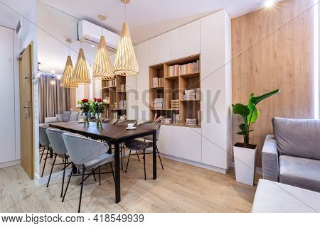 Table in living room in a small modern apartment. Interior design