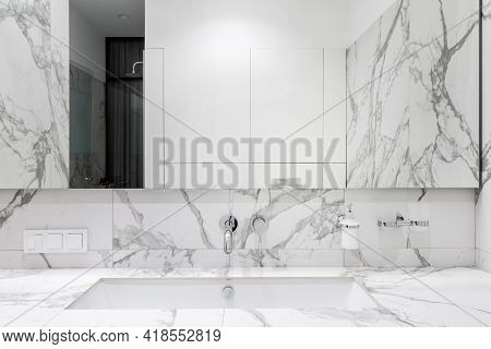 Bathroom Interior Concept. Mirror Over Inset Wash Basin In New And Modern Contemporary Apartment. Ma