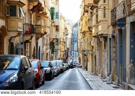St Julians, Malta - April 23: The Street And Traditional Old Buildings In Valletta On April 23, 2015