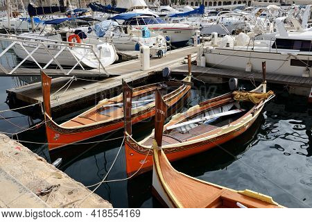 Birgu, Malta - April 24: The Traditional Wooden  Maltese Boats For Tourists Cruises On April 24, 201