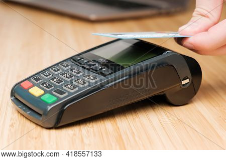 Close Up Man Hand Paying With Contactless Credit Card With Nfc Technology Using Wireless Payment Ter