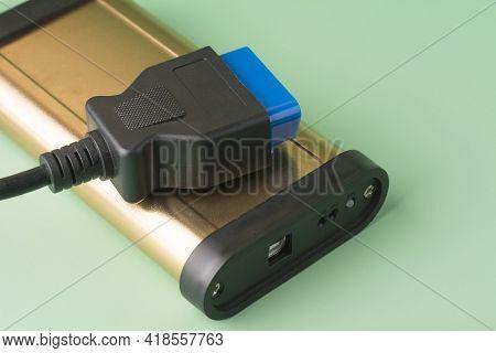 Car Diagnostic Scanner Obd2 On Mint Green Background. Equipment, Diagnostic Interface. Service, Repa