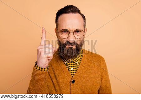 Photo Of Aggressive Strict Man Frown Raise Finger Wear Eyewear Brown Cardigan Isolated Beige Color B