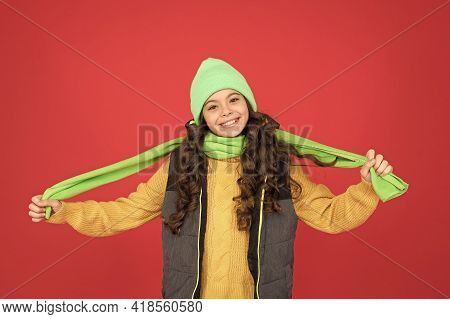 Cosy Scarf For Warmth. Happy Child Wear Hat And Long Scarf. Little Girl Smile With Scarf In Hands. F