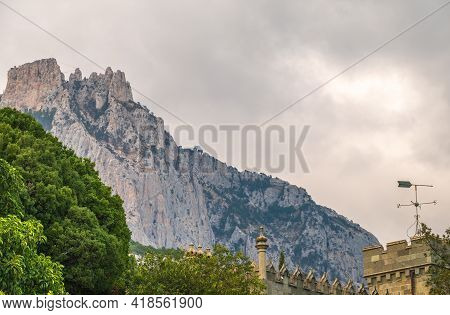 The Walls And Towers Of The Old Palace On The Background Of High Mountains And Cloudy Sky. Vorontsov