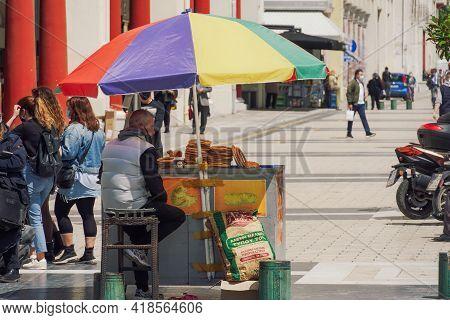 Thessaloniki, Greece - April 26 2021: Greek Round Sesame Bagel Street Sale. Outdoors Vendor On Stand