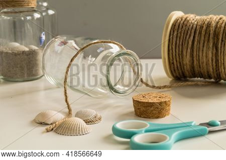Handmade Glass Diy Project. With Scissors, Cord And Shellfish. Creative Diy Concept.