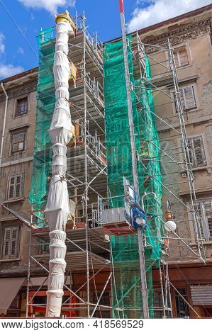 Chute Tube And Elevator At Construction Site Scaffoldings