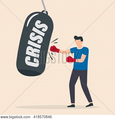 Businessman Breaks The Crisis With Boxing Gloves. The Concept Of Business And The Financial Crisis.