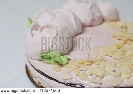 Marshmallow Cake. Layers Of Biscuit, Marshmallow And Jelly. Decorated With Marshmallow Roses And Alm