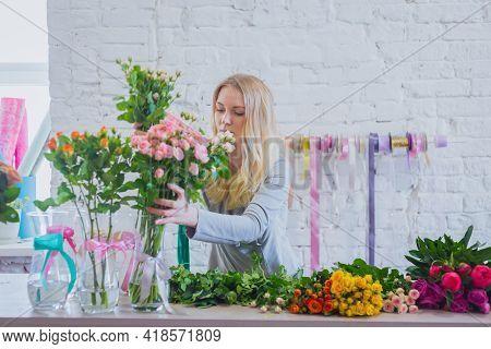 Portrait Of Professional Floral Artist, Florist Working With Flowers At Workshop, Flower Shop. Flori