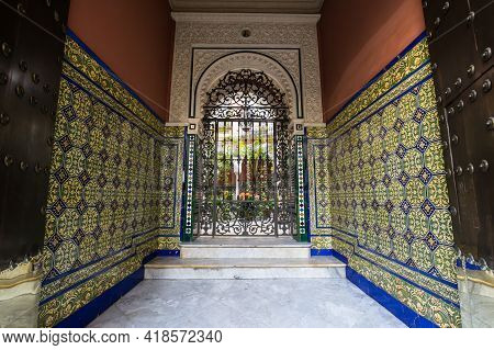Seville, Spain - 08 April, 2019: View Of The House In The Historical Center Of Seville, A Big Touris