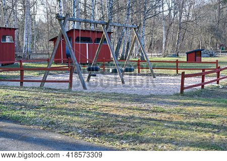Swings In Playing Area For Kids In April