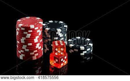 Dice With A Winning Combination In Poker And Chips On A Black Table. The Idea Of A Poker Game. Free