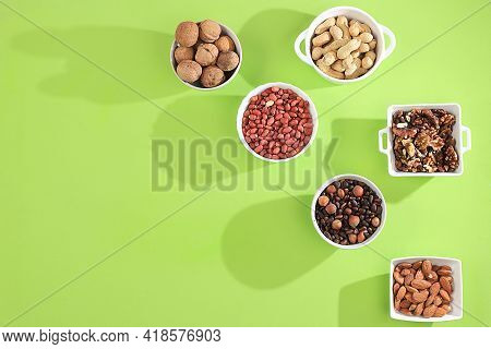 Assortment Of Assorted Nuts With Long Shadows, Healthy Natural Food Concept, Almonds, Pecans, Pistac