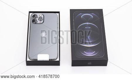 Bangkok, Thailand - Apr 27, 2021: Studio Shot Of New Apple Iphone 12 Pro Max Graphite Color, Unbox S