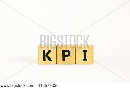 Kpi, Key Performance Indicator Symbol. Wooden Cubes With Word 'kpi, Key Performance Indicator' On Be
