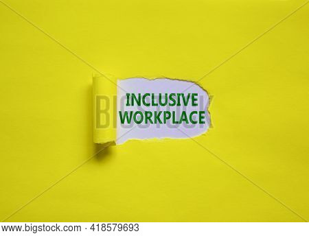 Inclusive Workplace Symbol. Concept Words 'inclusive Workplace' Appearing Behind Torn Yellow Paper.