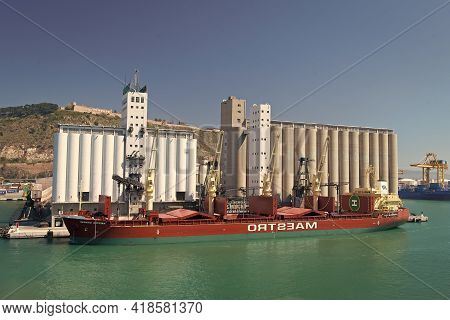 Barcelona, Spain - March 30, 2016: Bulk Ship Maestro With Cranes In Sea Port. Bulk Shipment. Shippin