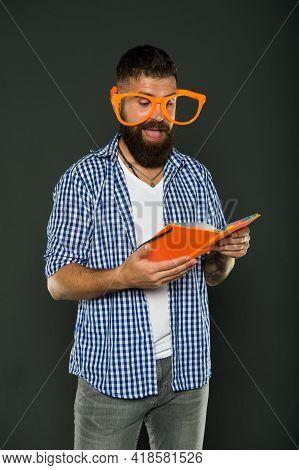 He Enjoying The Stories. Book Nerd Wearing Fancy Glasses. Study Nerd Reading Book. University Male S