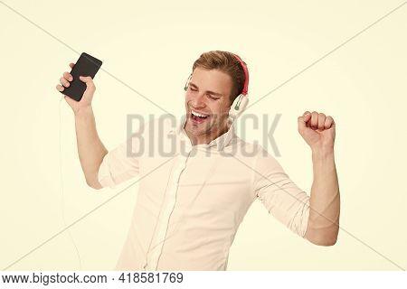 Best Song Ever. Man Listening Favourite Song Headphones With Smartphone. Guy Earphones Listens Music