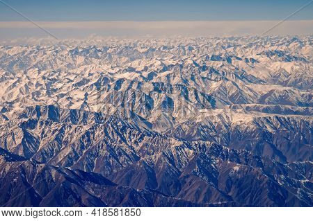 Mountains With Snow, Aerial View. Earth Surface. Environment Protection And Ecology. Wanderlust And