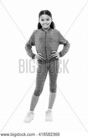 Deal With Long Hair While Exercising. Girl Cute Kid With Long Ponytails Wear Sportive Costume Isolat