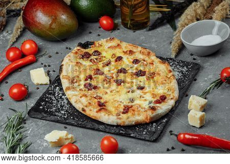 Hot Four Cheeses Delicious Rustic Homemade American Pizza With Thick Crust On Black Table