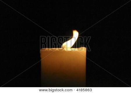 One Candle With Blowing Flame