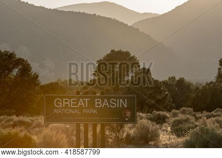 Great Basin National Park, United States: August 4, 2020: Sun Haze Over Great Basin Sign At Park Bou