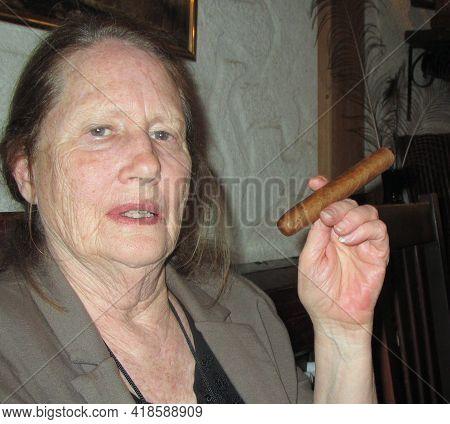 Havana, Cuba, March 29, 2016. Circa: Mature Female On Vacation Smoking A Cigar In Havana, Cuba.