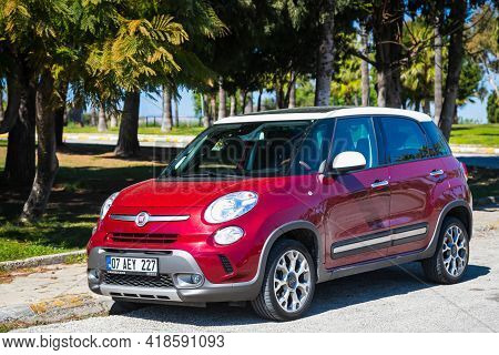 Alanya, Turkey - April 15 2021: Red Fiat 500  Parked On The Street On A Warm Summer Day Against The