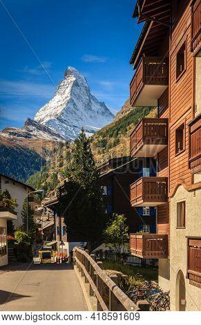 A street in the Swiss resort town of Zermatt with a view of Matterhorn