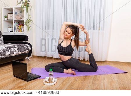 Fitness Healthy Lifestyle Exercises. Female Watching Online Classes. Home Workout. Woman Doing Yoga.