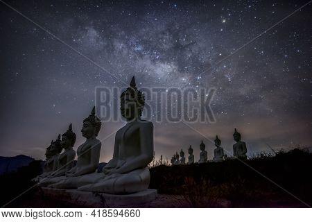 Milky Way Galaxy Over Many Of Buddha Statues At Phu Phra Ban Mak Khaeng, Dan Sai, Loei, Thailand.