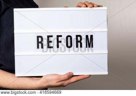 Reform. Text In Light Box. Medicine, Education And Economics Concept