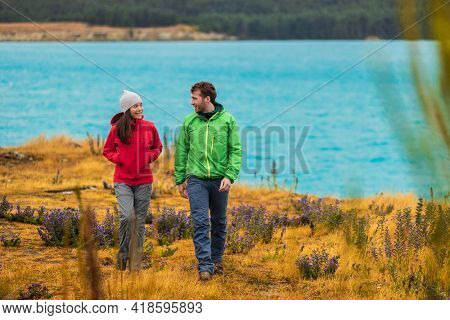 New Zealand travel by Lake Pukaki. Tourists couple hiking in nature near Aoraki aka Mount Cook at Peter's lookout, a famous tourist destination on New Zealand.