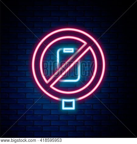 Glowing Neon Line No Cell Phone Icon Isolated On Brick Wall Background. No Talking And Calling Sign.